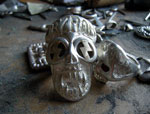 Skull Ring With Gold Bolts