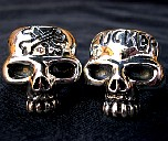 133D. Couple Of Silver Skull Rings.jpg