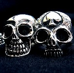 38. Couple O SIlver Skull Rings.jpg