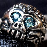 69M. Blue Eyed Monkeyman Skull Ring.jpg